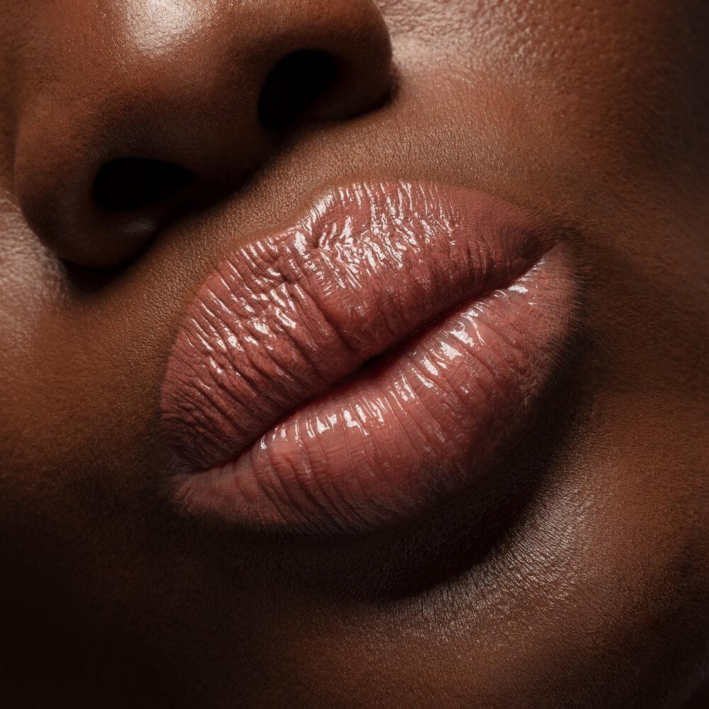 model in beige shiny lipstick
