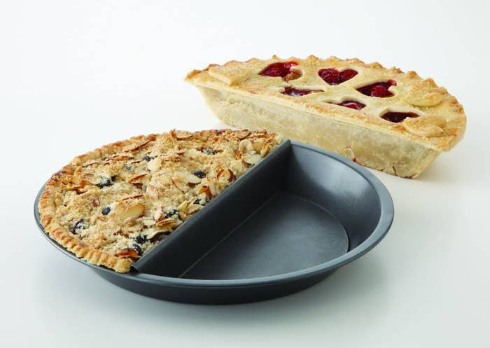 A pie pan with a divider in the middle One half the pin is in the pan and the other half is sitting beside it