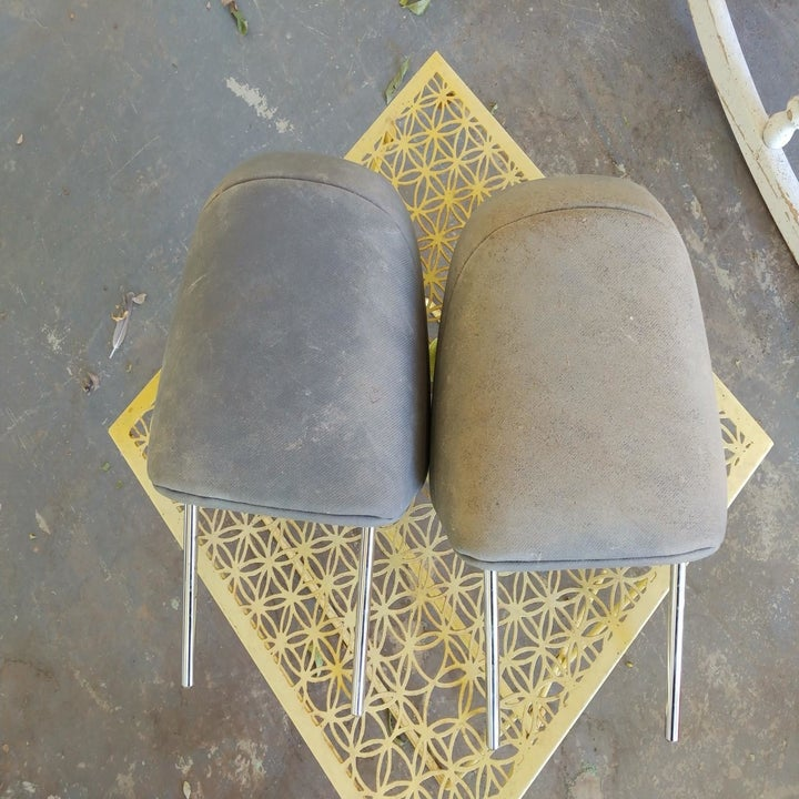 A reviewer's car head rests looking dusty and dirty to the point of discoloration