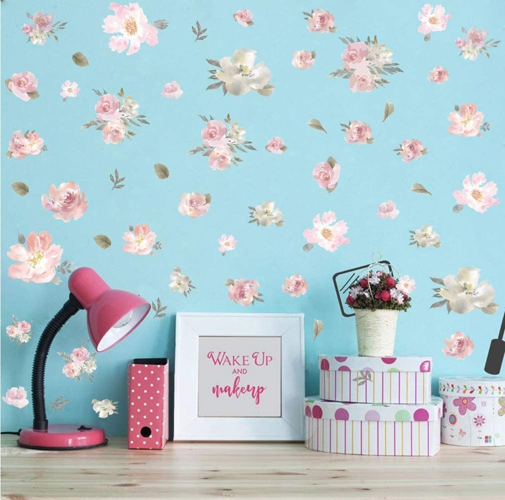 A wall behind a desk covered in peony decals