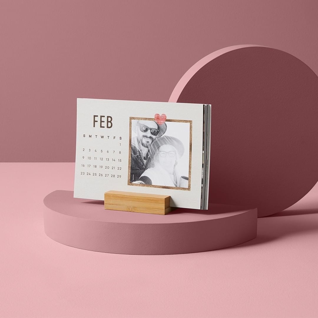 a pink backdrop with the small easel calendar showing a design for february