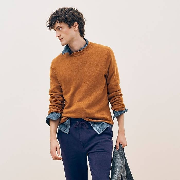 Model wearing J.Crew rugged merino crewneck sweater in heather squash