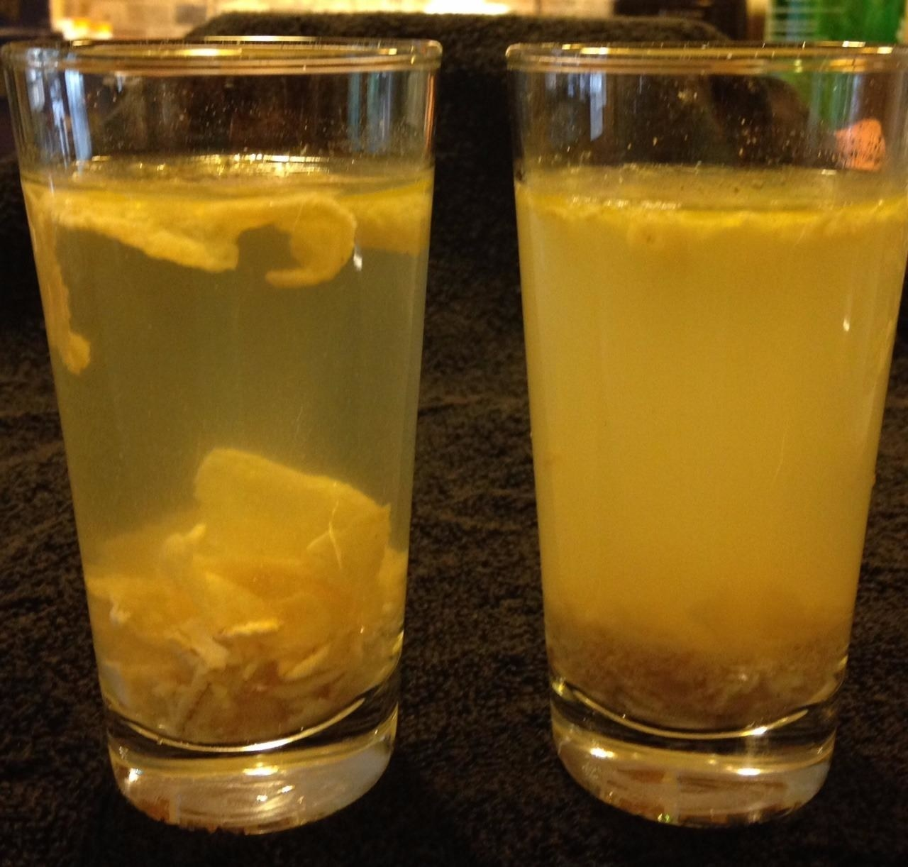 left: lots of solid matter in yellow liquid in glass right: more powdery like matter in same yellow color liquid in glass