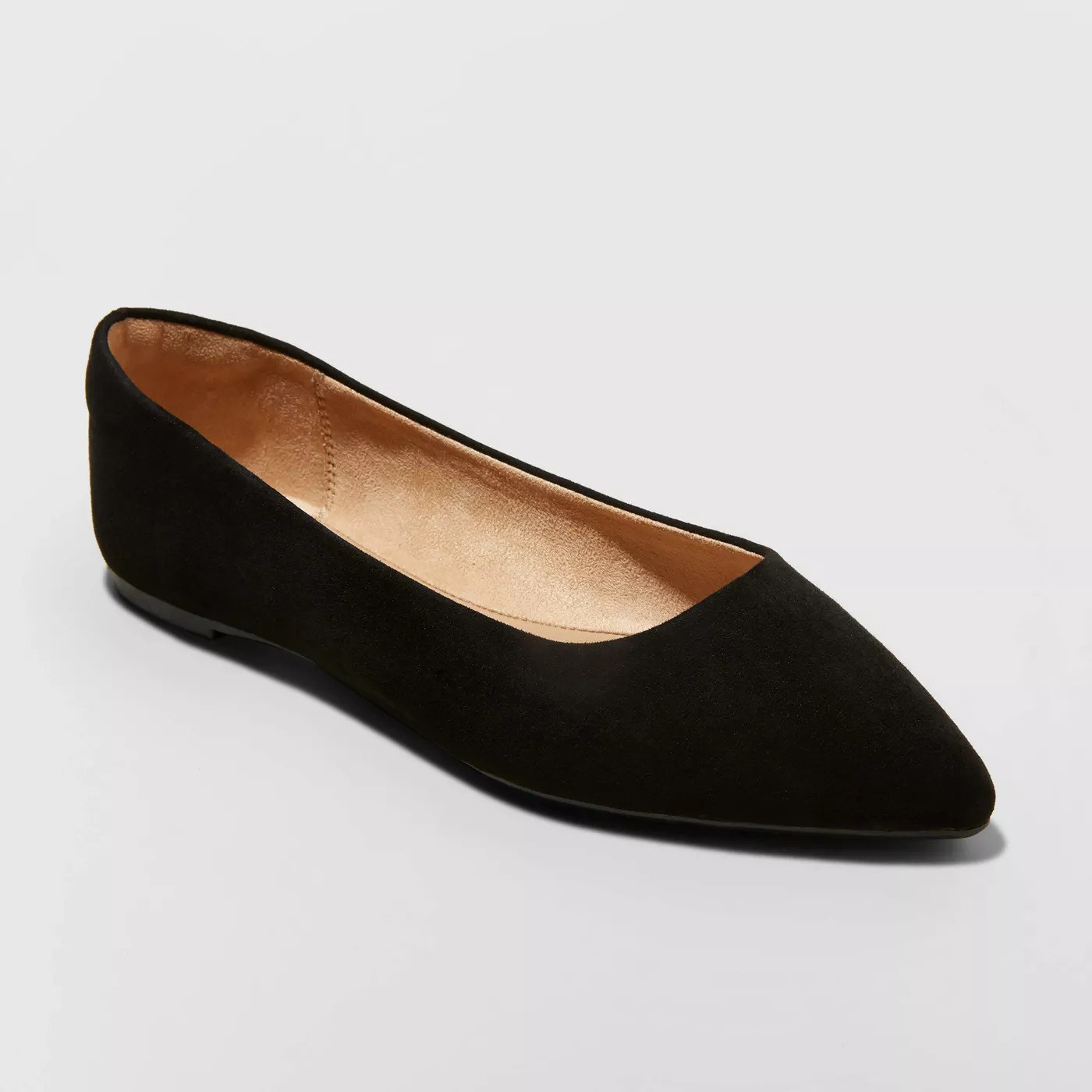 A single black flat with a pointed toe