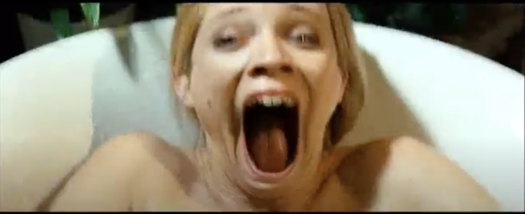 "Bathtub scene in ""Mirrors,"" where a woman's demons breaks its own jaw and thus breaks hers"