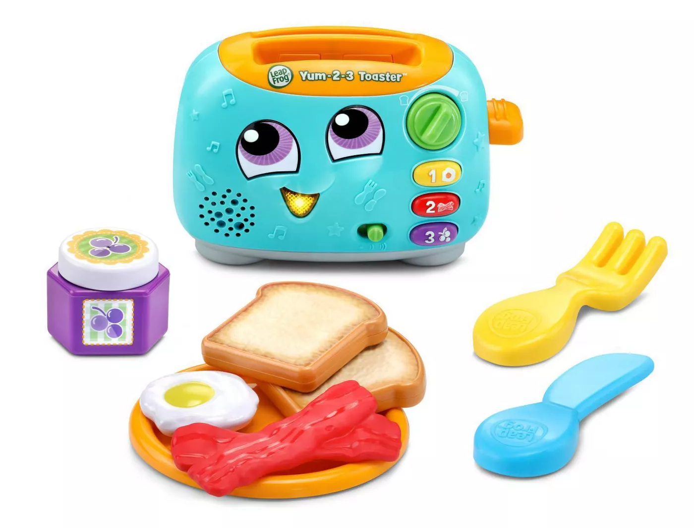 Teal and orange plastic toaster toy with a face along with a plate of toy food and utensils