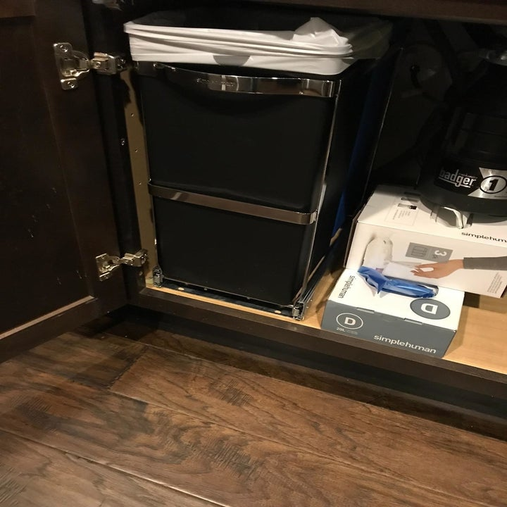 The same customer's pull-out bins pushed under the sink