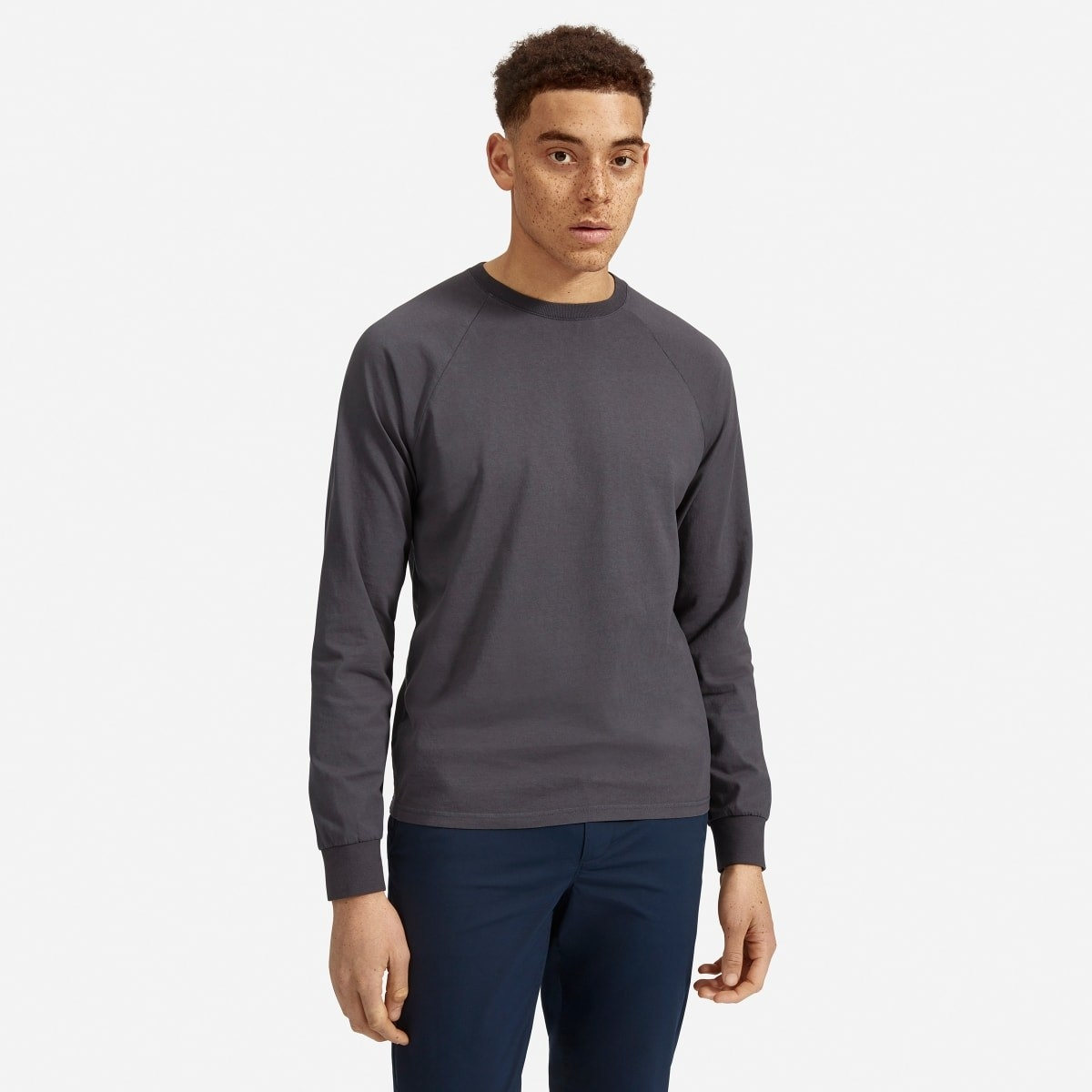 Model wearing Everlane premium-weight long-sleeve crew in washed ink gray