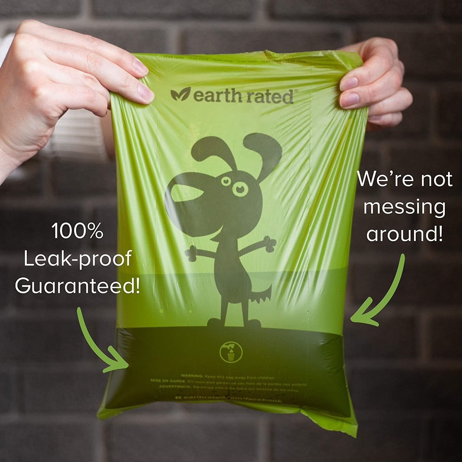 The poop bag with text that they're 100% leak-proof