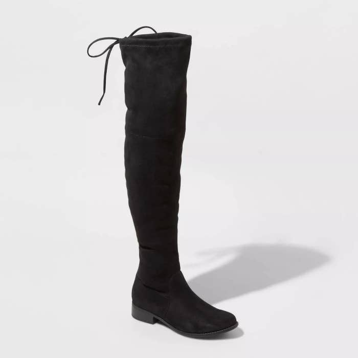 a black microsuede over the knee boot with a tie string at the top