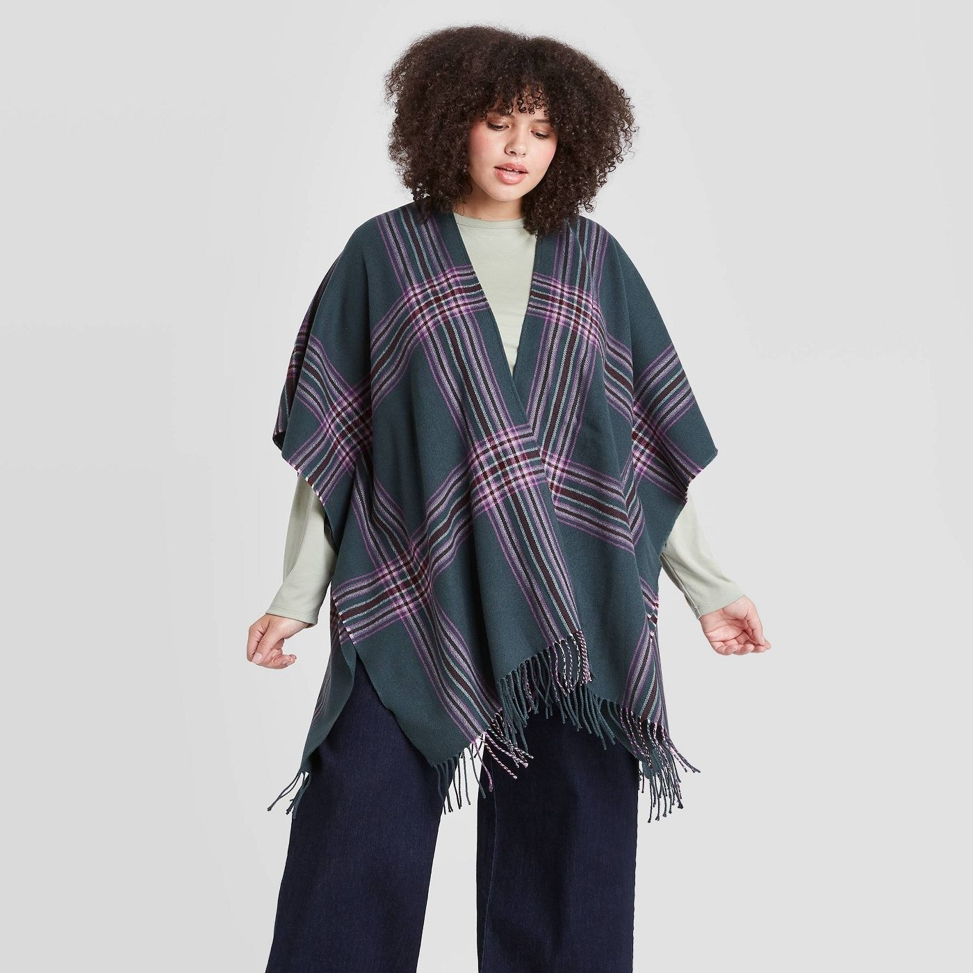 Model in the fringed scarf cape