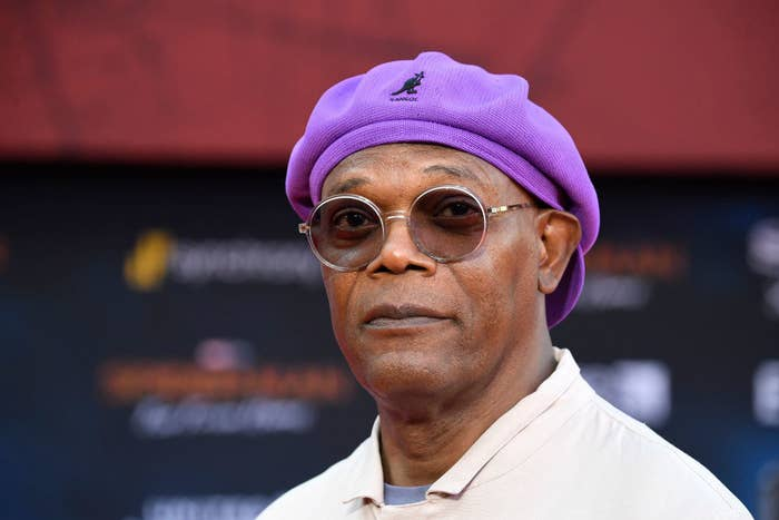 Samuel L. Jackson wearing a hat and sunglasses