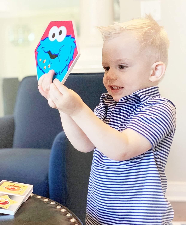 Child model holding up large Cookie Monster Magnatile