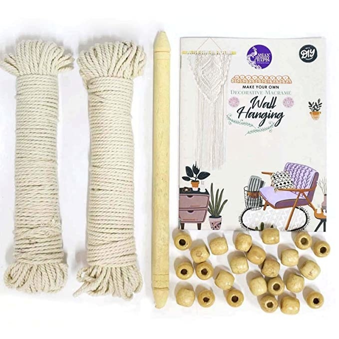 Ropes, beads and other parts of the macrame wall hanging kit.