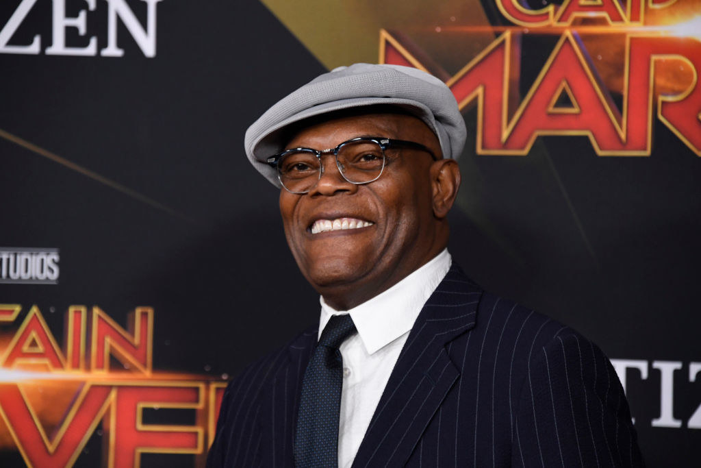 Samuel wearing a hat and glasses at a premiere