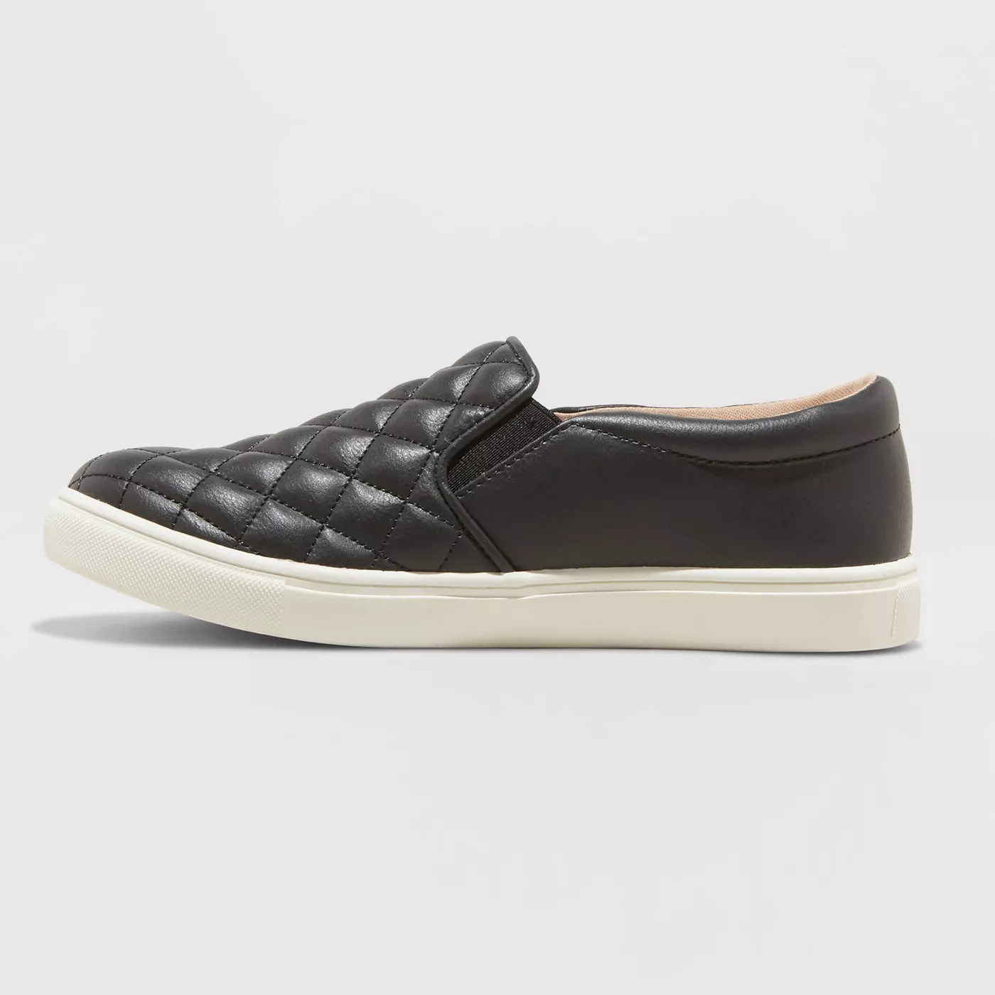 a quilted black faux leather upper with a white rubber sole