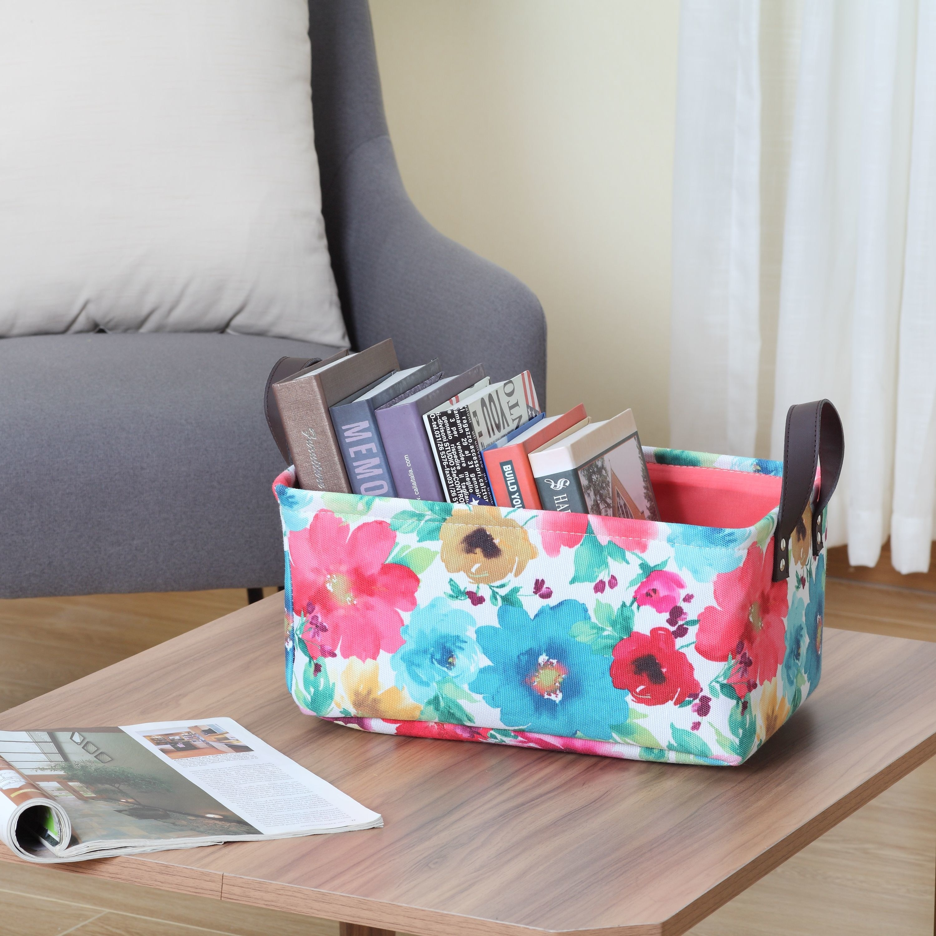 A colorful floral canvas tote on a coffee table storing books inside