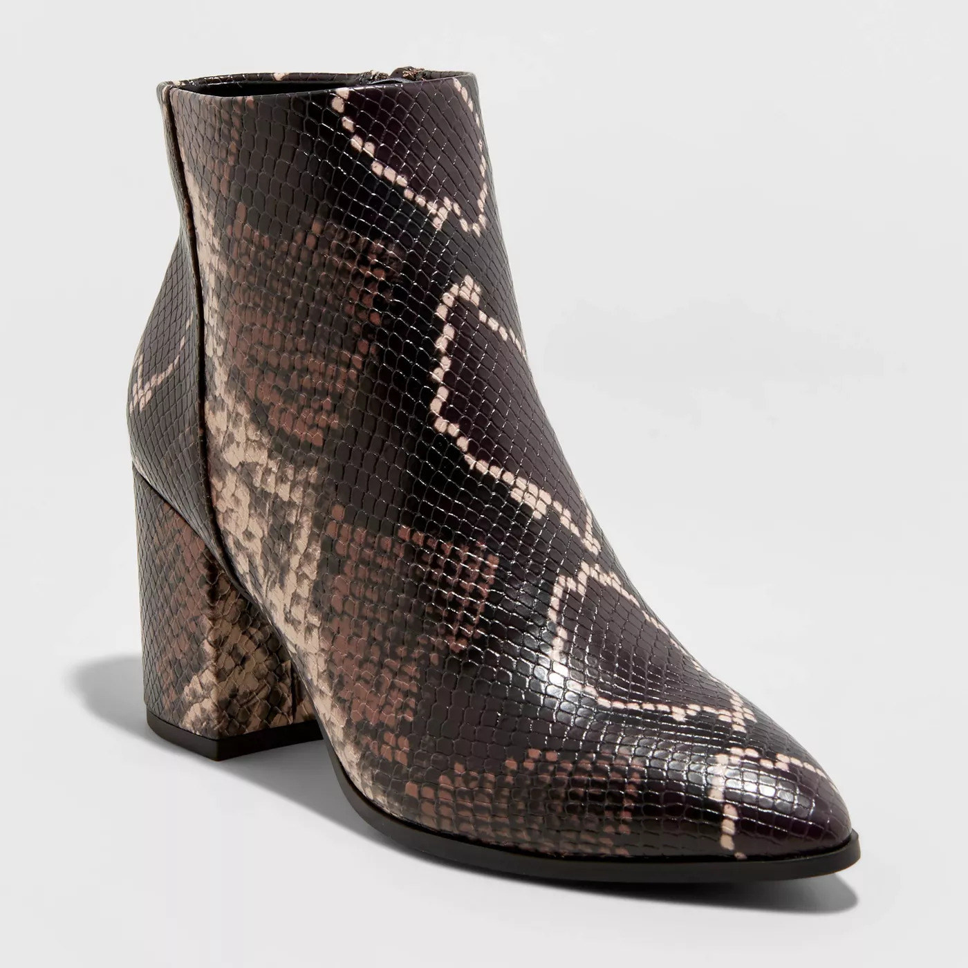 Brown beige and black snakeskin ankle boots with a block heel and pointed toe