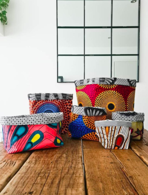 Colorful African-inspired fabric storage baskets on a hardwood floor