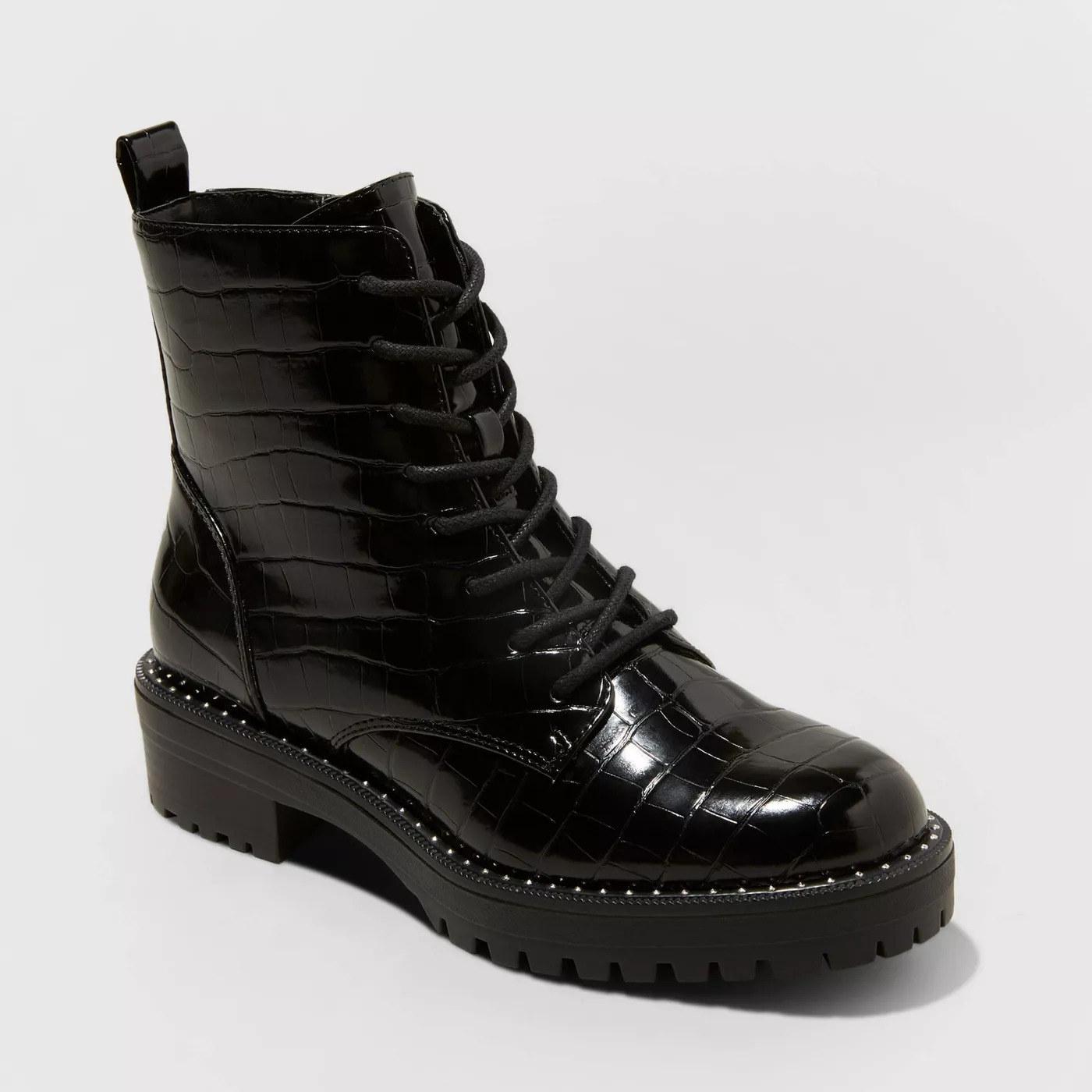 black semi-patent faux crocodile combat boots with laces and black rubber soles