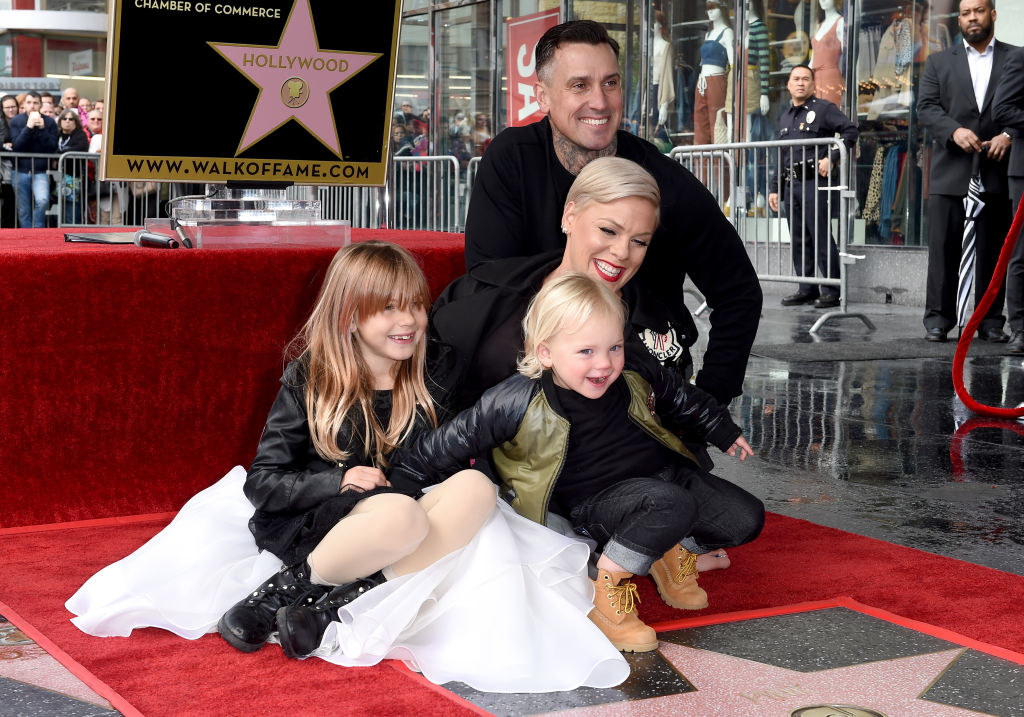 Carey Hart, Pink, and their children posing as Pink receives her star on the Hollywood Walk of Fame