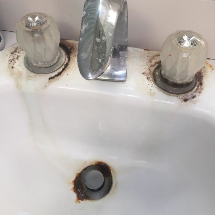 A customer's sink covered in mold and mildew