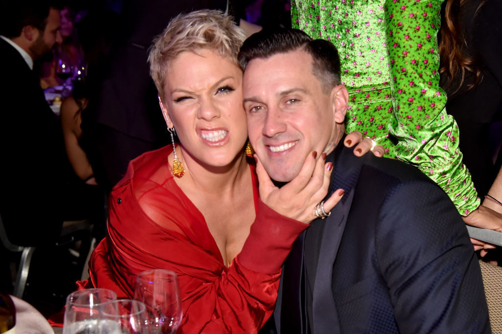 Carey Hart and Pink posing together at a Hollywood event
