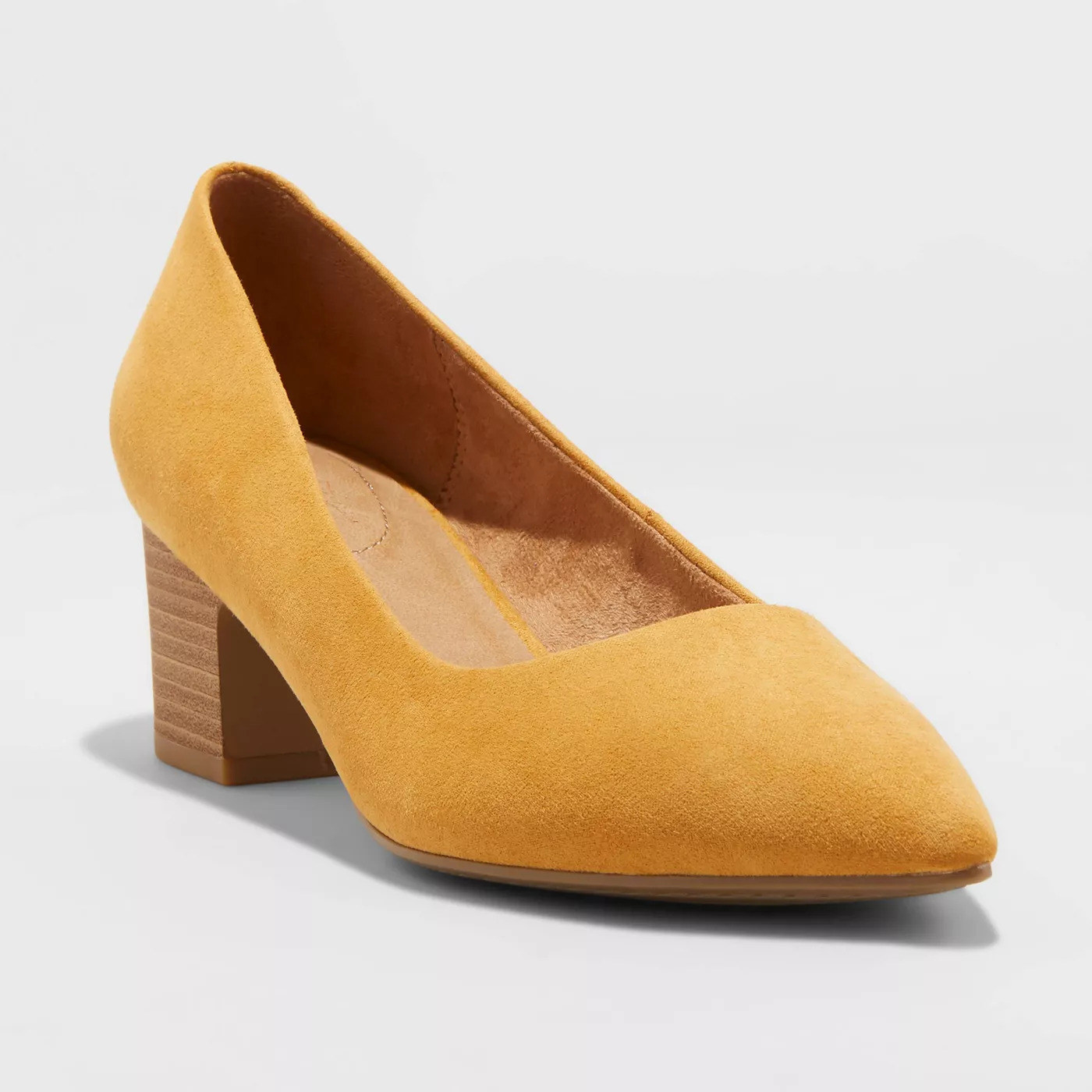 a mustard suede pointed pump with a brown block heel
