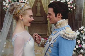 Cinderella and Prince Charming from the live-action Cinderella standing at the altar at their wedding surrounded by beautiful flowers