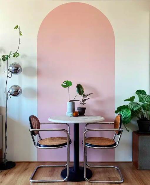 a wall with a pink rounded stripe in the middle