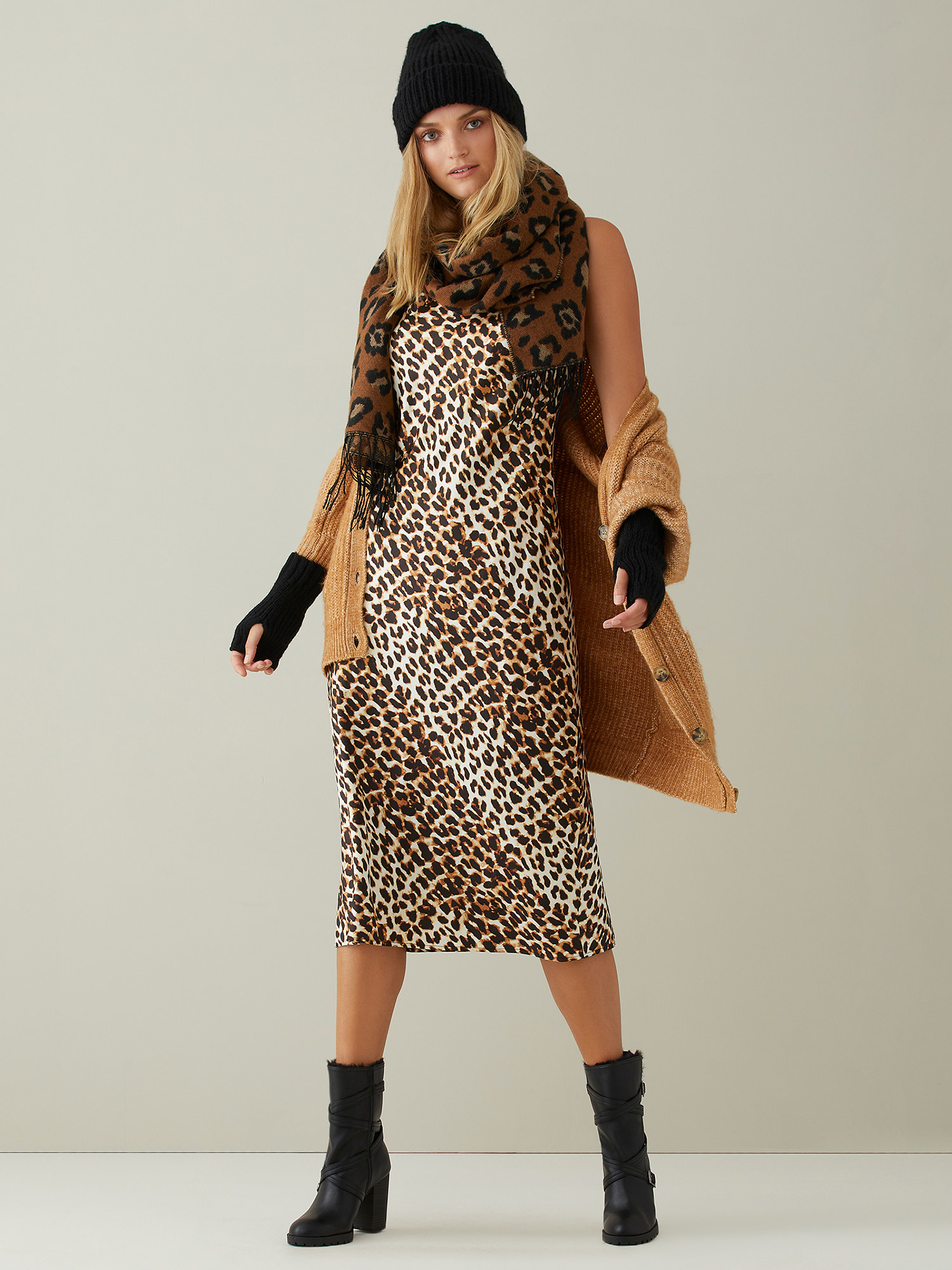 The leopard slip dress layered with a scarf and jacket