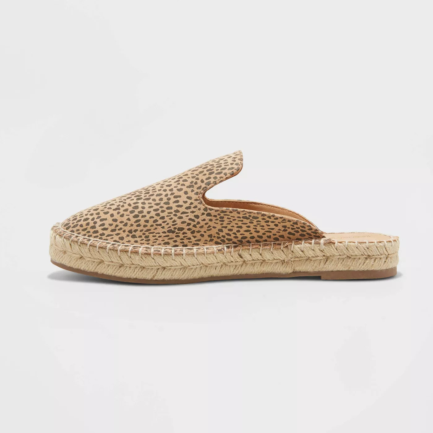 a beige and brown animal print mule with an espadrille sole
