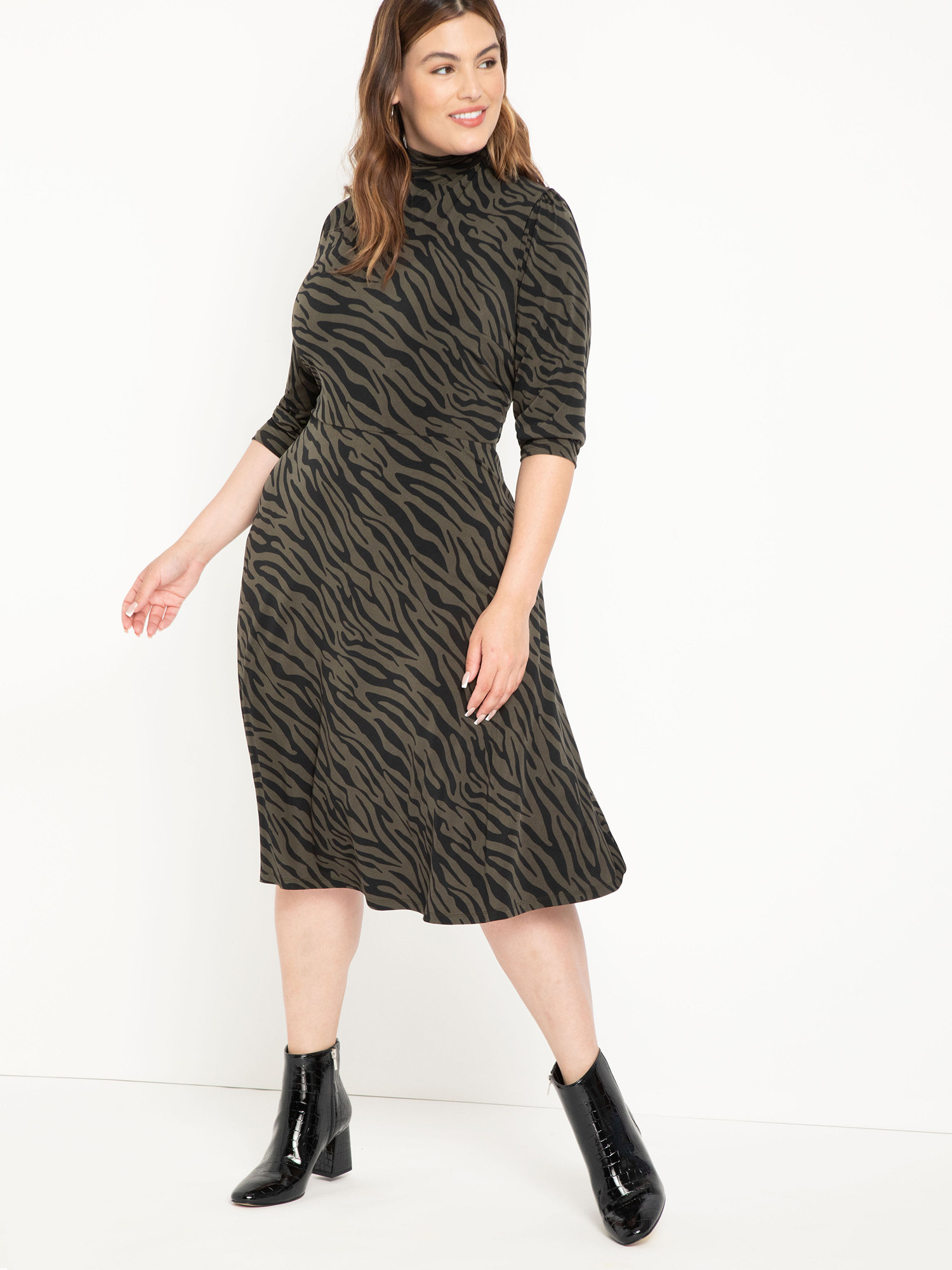 The green and black zebra-print dress