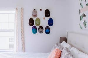 Hats hanging on wood hooks