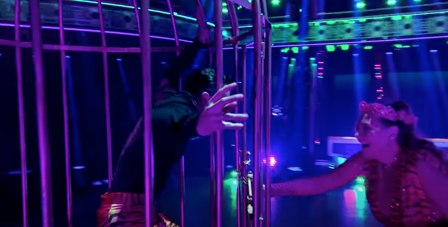 Carole Baskin and Pasha Pashkov exiting large cage at beginning of dance