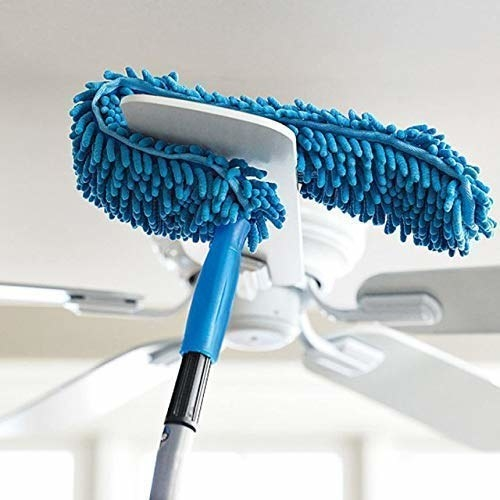 The brush cleaning a ceiling fan.