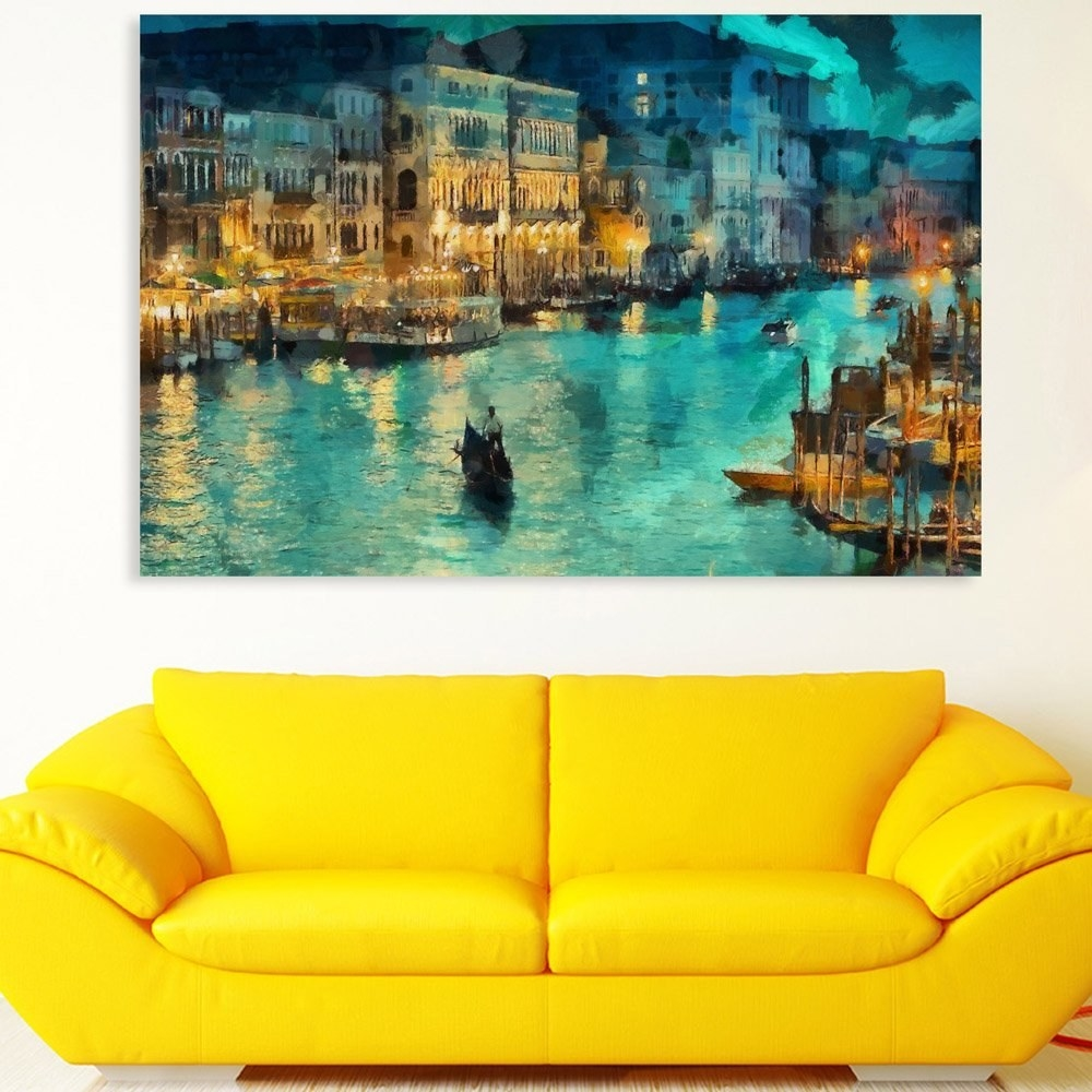 A painting of a boat in Venice hung up on a wall behind a yellow sofa