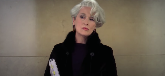 """Miranda looking uninterested and unbothered in """"The Devil Wears Prada."""""""