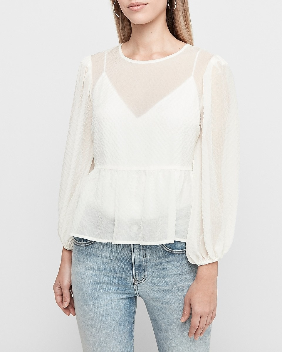 Sheer balloon-sleeve white top with V-neck cami underneath