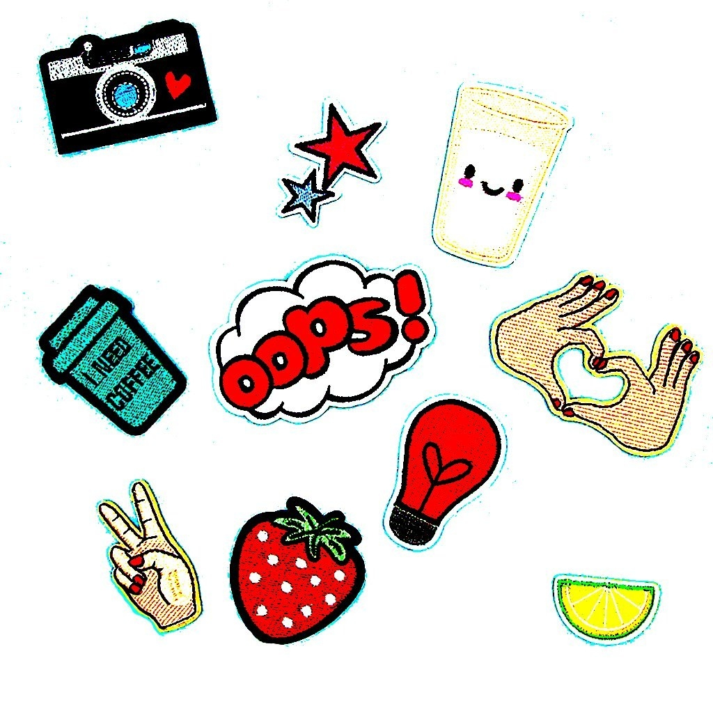 """An assortment of iron-on patches that includes doodles of a camera, a hand showing the peace sign, two hands forming a heart, a strawberry, a bulb, half a lemon, a coffee cup, a drink cup, an exclamation bubble that says """"Oops!"""" and two stars."""