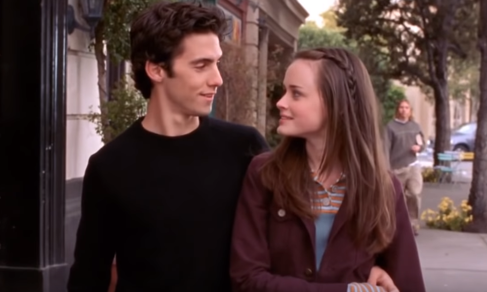 """""""Gilmore Girls"""" characters Jess and Rory staring into each other's eyes"""