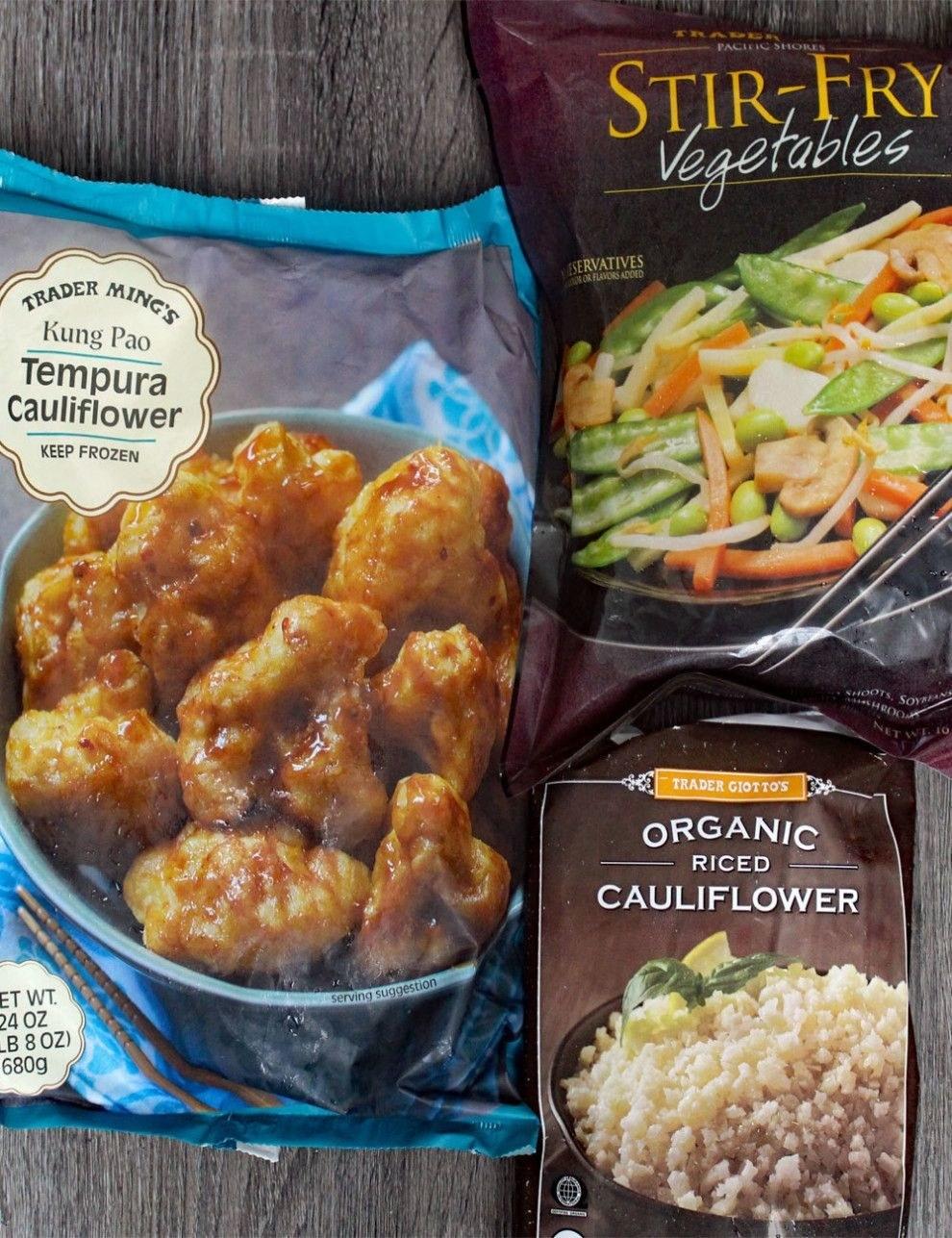 Frozen tempura cauliflower, riced cauliflower, and stir fry vegetables on a countertop.