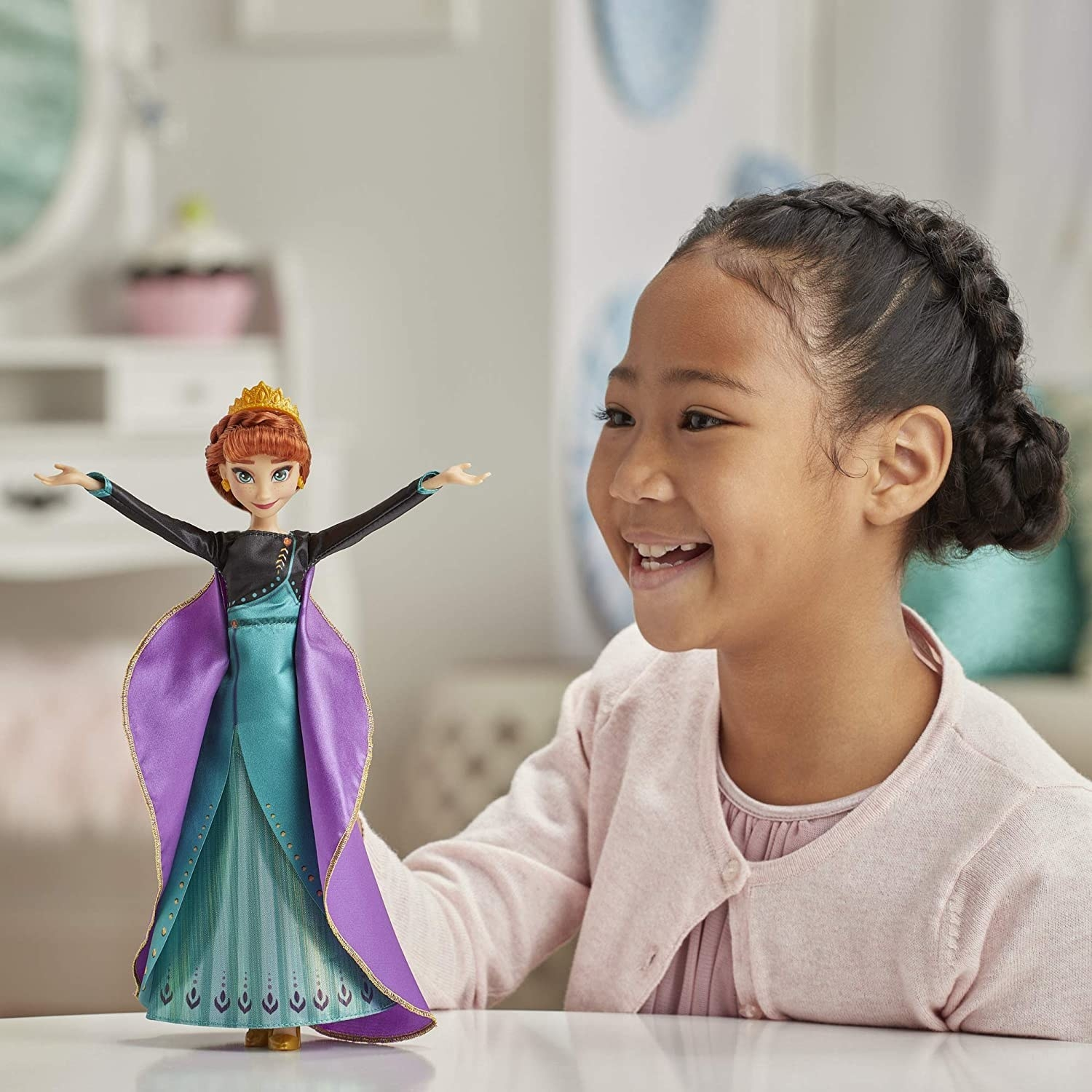 Model child playing with the Anna singing doll