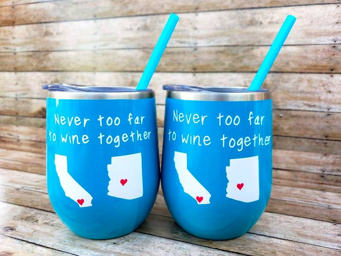 """Blue wine tumblers with blue straws that say """"never too far to wine together"""" with California and Arizona states"""