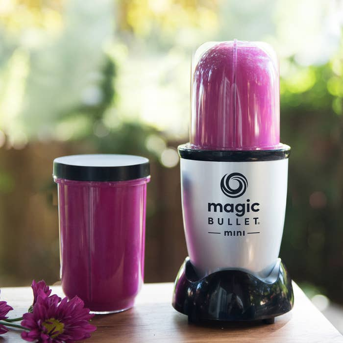magic bullet mini blender with purple smoothie inside