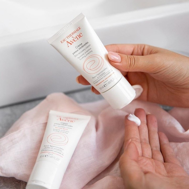 model squeezing cream out of white tuve