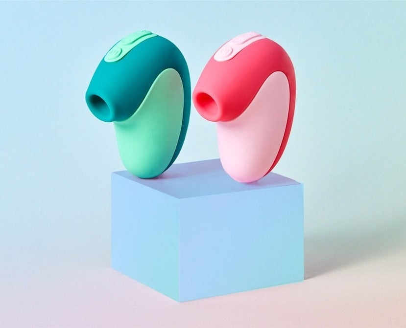 Two curved suction toys side-by-side