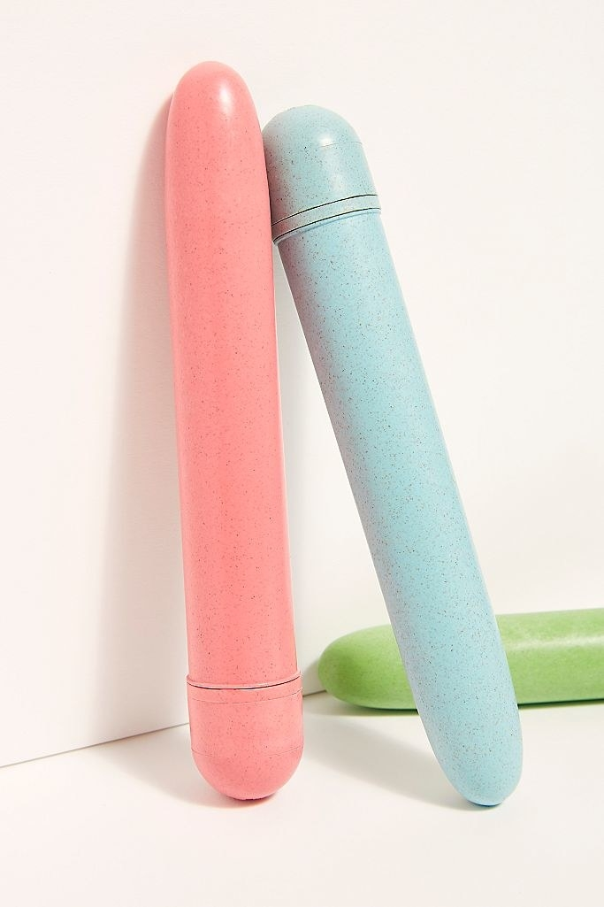 Three vibrators in pink. blue, and green