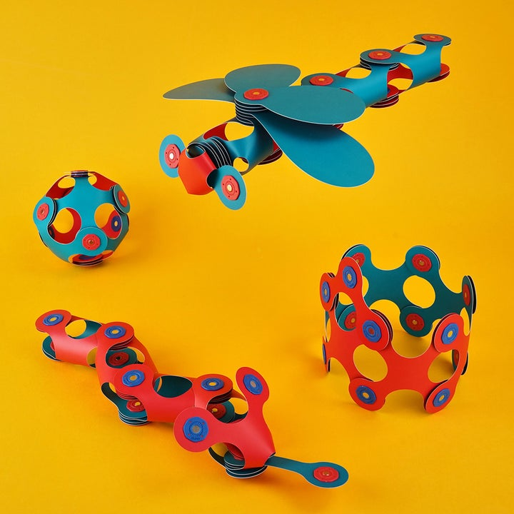 Clixo toys assembled into a ball, plane, snake, and crown