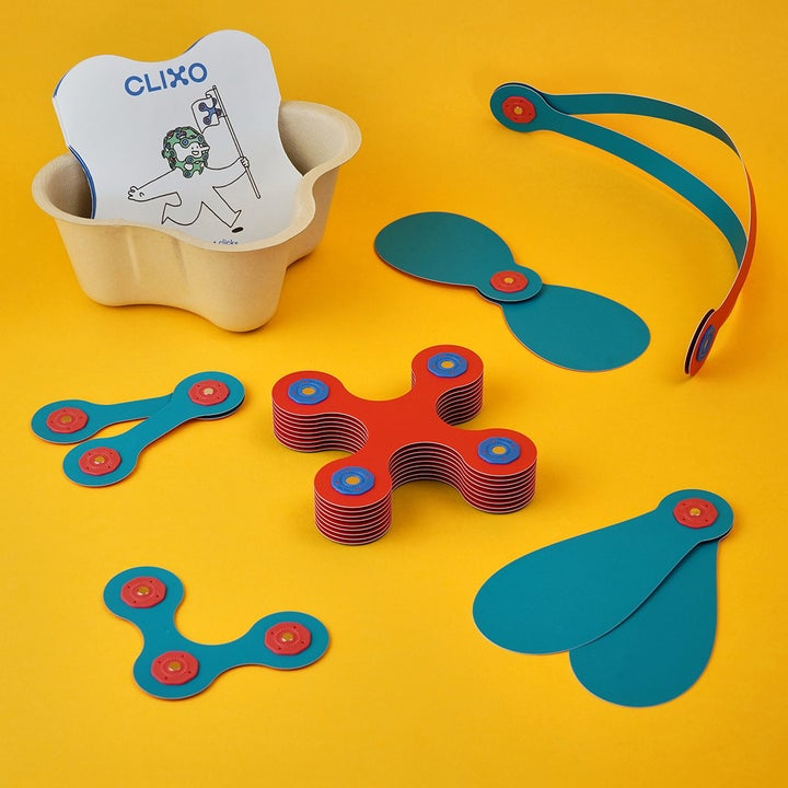 A set of flamingo and turquoise colored Clixo toys unassembled
